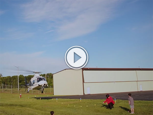 Dad uses Helicopter to pull son's tooth (Video)
