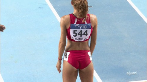 Feamle athlete shaking her sexy booty to warm up before running. gif