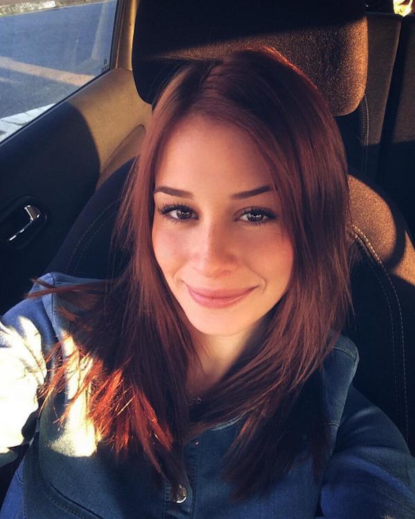 Cute Julia Roberts doppelganger redhead with juicy lips takes selfie in blue jacket top
