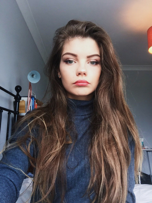 Gorgeous light-eyed brunette with juicy lips takes selfie in blue turtleneck tee