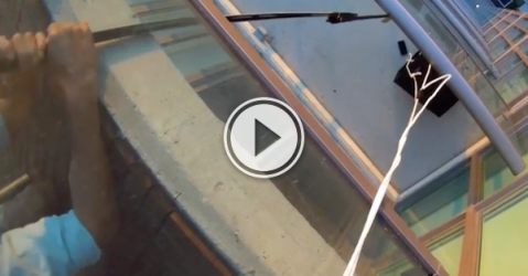 Of course a hockey stick is involved in a McGuyvered phone rescue (Video)
