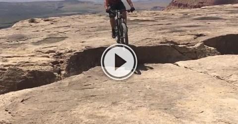 Screenshot of a mountain biker on a cliff