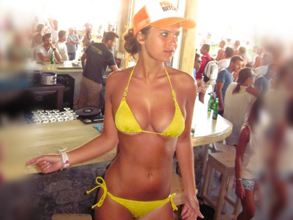 Gorgeous woman in orange cap flaunts her bouncy supple boobs and curvaceous body in tiny yellow bikini