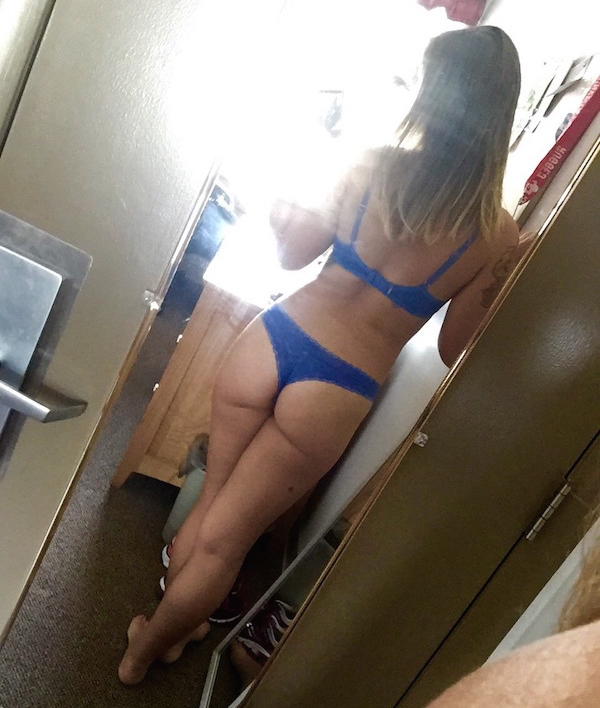 Blonde flaunts supple butt cheeks and sexy body in blue bra and panties