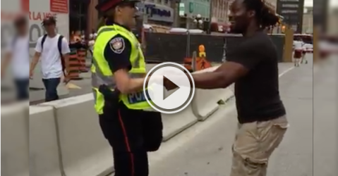 Ottawa officer and a pedestrian engage in a fun dance! (Video)