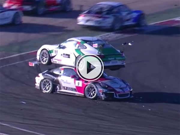 Porsche Carrera rally crash ends with car on top of other (Video)