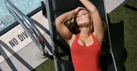 Beautiful blonde with sexy body strikes a pose in red swimsuit