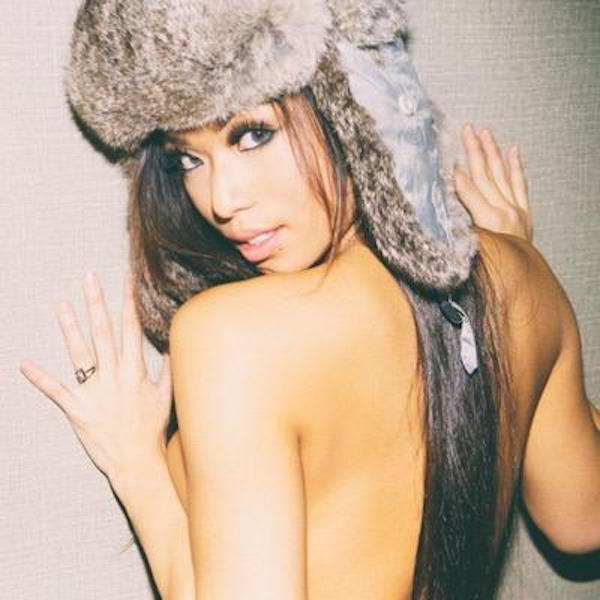 Hot model posing nude with a fur headgear