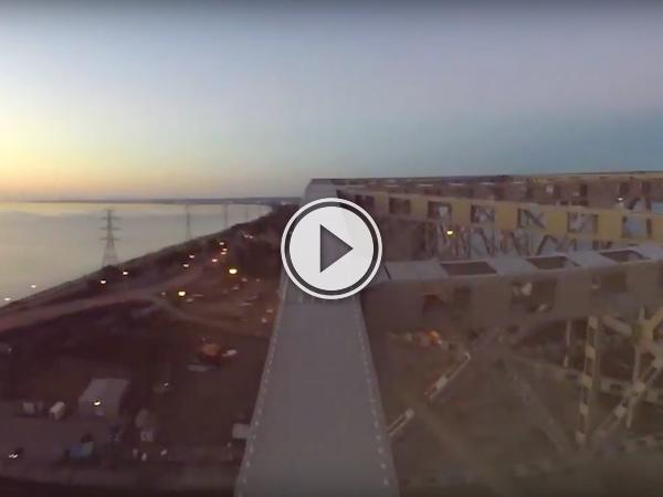 Dude climbs up the Skyway bridge in Burlington, like it's no big deal (Video)
