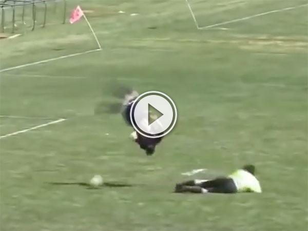 High school soccer player flips over goalie (Video)