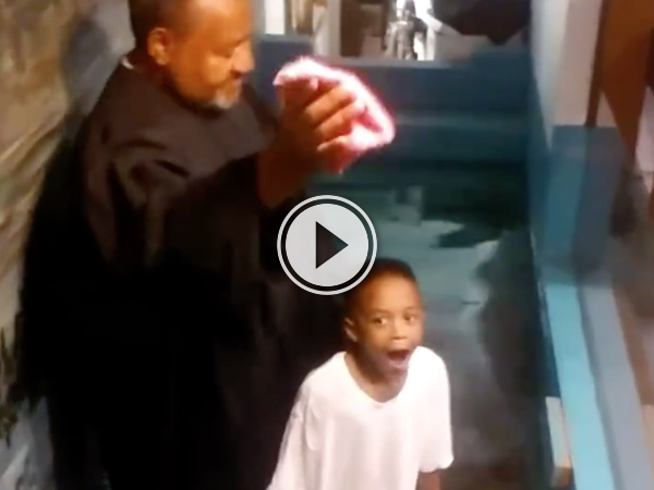 Overly excited boy baptizes himself (Video)