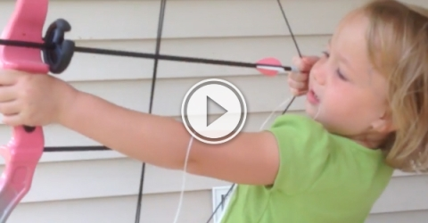 Adorable girl uses bow to pull out tooth (Video)