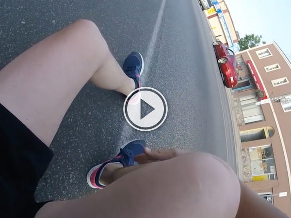 Dude takes out a cyclist and offers him a napkin? Really? (Video)