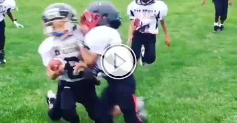 Ouch, kid gets sacked by his own teammate! (Video)
