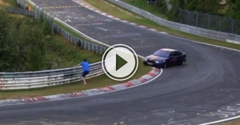 Guy almost gets run over by car (Video)
