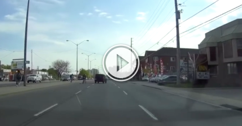 Jeep narrowly misses four idiots dashing across the road! (Video)