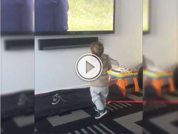 This kid's so into golf, he'll practice with anything! (Video)