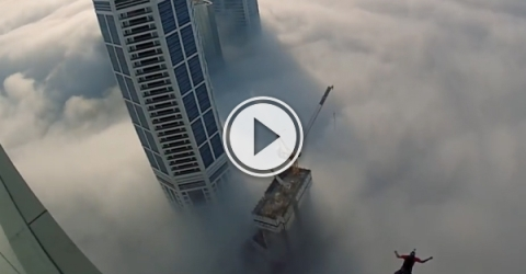Base jumping through a fog of skyscrapers (Video)