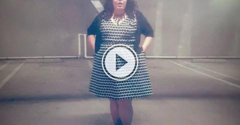 Woman sings opera in an empty parking garage
