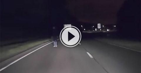 Driver narrowly misses drunk man on motorway (Video)
