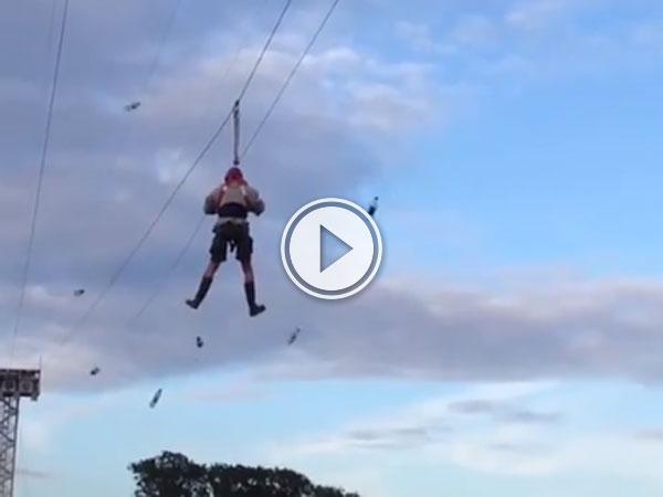 Poor guy stuck on a zip line becomes target practice (Video)