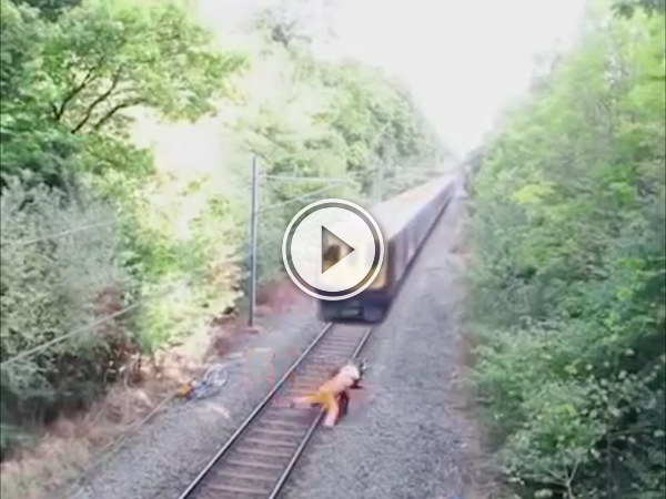 Drunk guy has trouble with tracks and narrowly avoids a train (Video)