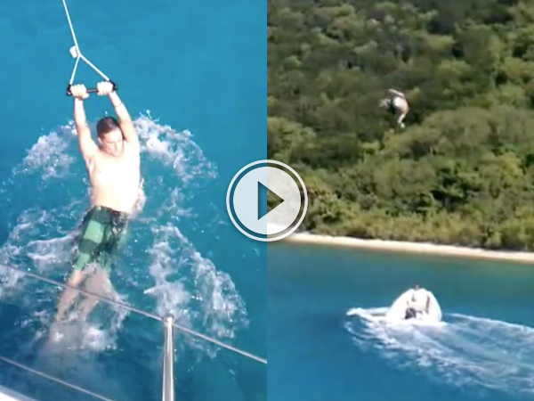 Guy gets launched into air, almost destroys boat with his own body.