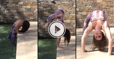 Girl climbs out of pool like she's in a horror movie (Video)