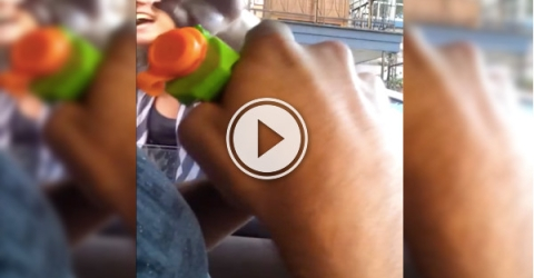 Road rager has a gun pulled on them - a squirt gun! (Video)