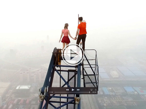 Daredevil couple climb china's tallest crane on a date (Video)