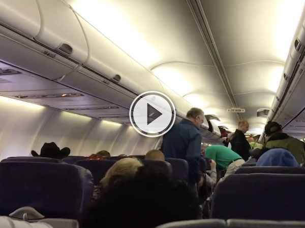 Flight attendant has a song in her heart, and she's getting it out! (Video)