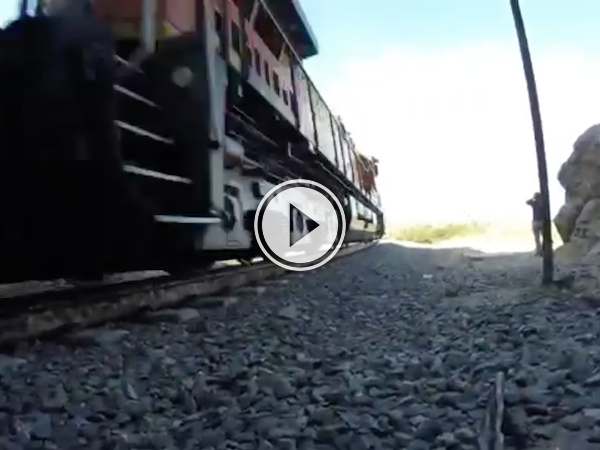 Dudes assume a train tunnel is abandoned. They're wrong! (Video)