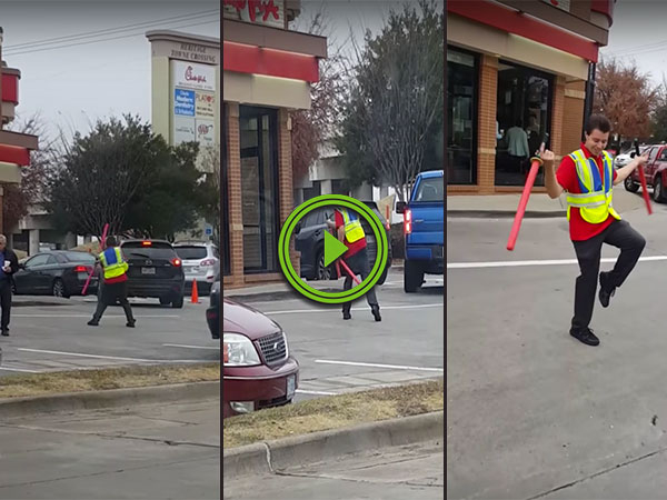 Parking attendant uses batons like lightsabers (Video)