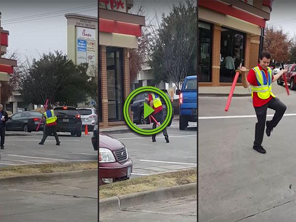 Parking attendant uses batons like lightsabers (Video)