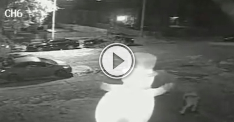 What the hell does this guy have against inflatable lawn snowmen? (Video)