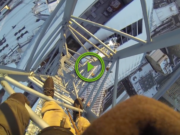 If you climb an ice covered crane, you're gonna have a bad time (Video)