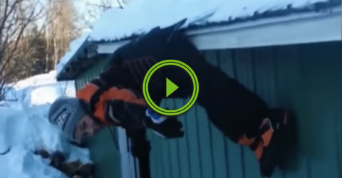 Kid falls off a snowy roof, but doesn't nail the landing (Video)