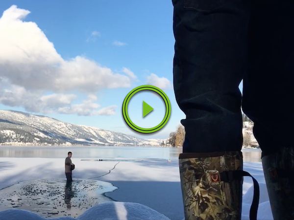 Dude jumps into the cold lake to rescue a trapped dog (Video)