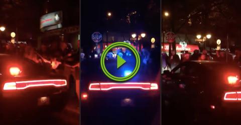 Holiday revellers serenade a cop with 'Police Navidad' (Video)