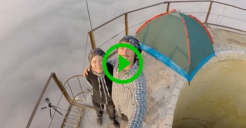 Insane daredevil camps on and climbs around atop chimney