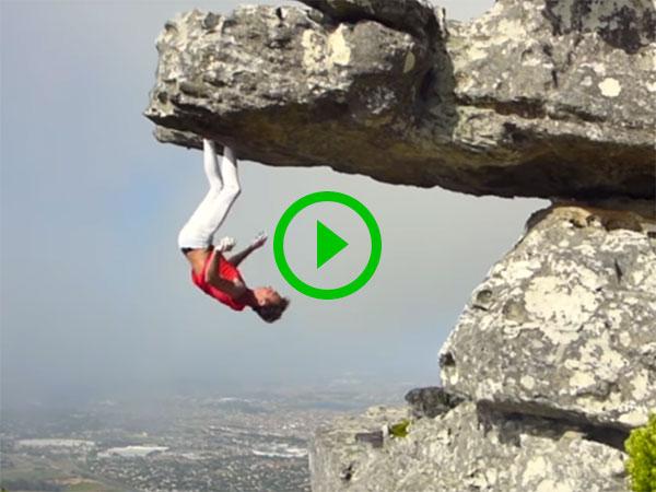 Rock climber hangs upside down from rock face (Video)