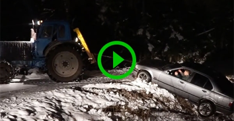 Tractor pulling car out of ditch only makes it worse (Video)