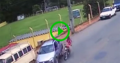 Motorcyclist has dramatic crash with car (Video)