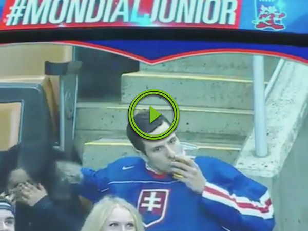 Hockey fan's got his priorities straight, that's for sure (Video)