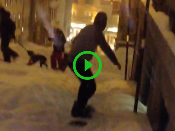 Guy snowboarding down street gets hit by car (Video)