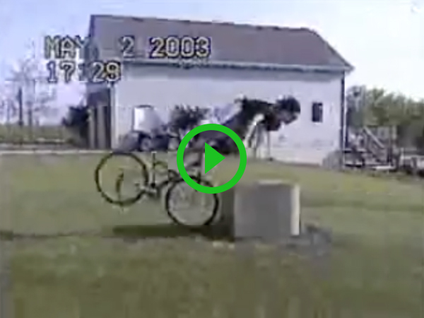 Guy rides full speed into metal box and flys off his bike