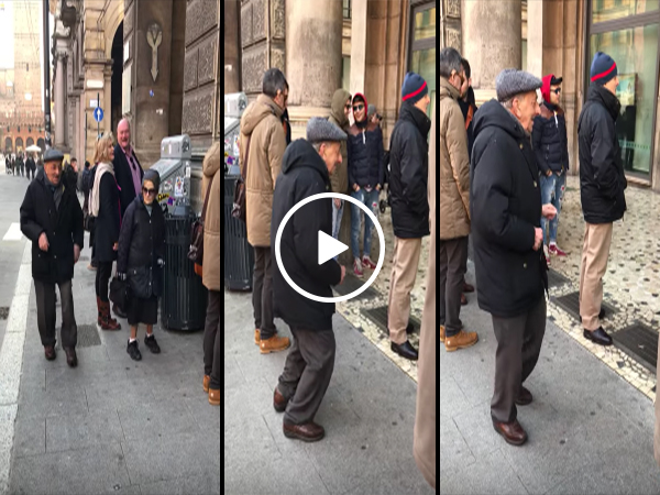 Elderly man dances in the streets of Italy