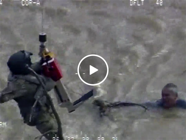 Dramatic helicopter rescue of man who nearly died in flood waters (Video)