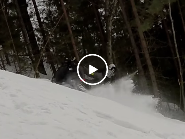 Man gets hit by own snowmobile on climb (Video)