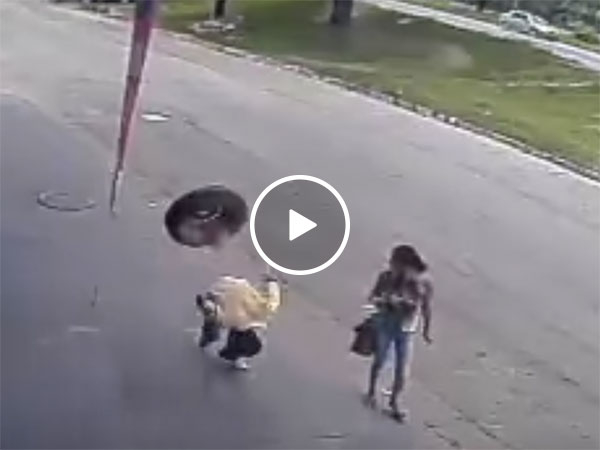 Man hit in head by tyre in freak accident (Video)